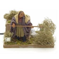 contadino con fieno in movimento