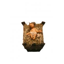 Bambinello nella culla di legno